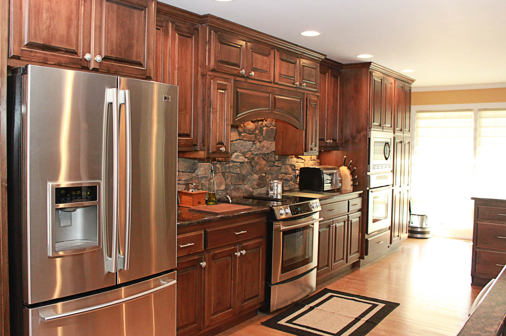 The cabinets plus clear alder kitchen cabinets for Alder kitchen cabinets